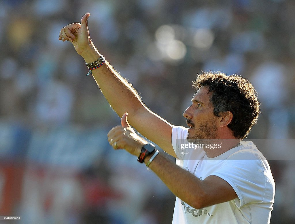 Tigre's team coach Diego Cagna gives the thumb up during their Argentina first division football match against Banfield in Victoria Buenos Aires...
