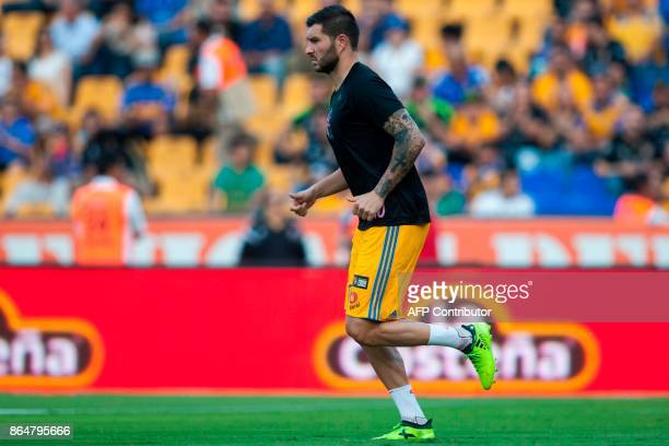 Tigres's footballer French AndrePierre Gignac warms up before the start of the Mexican Apertura 2017 tournament football match against Toluca at the...