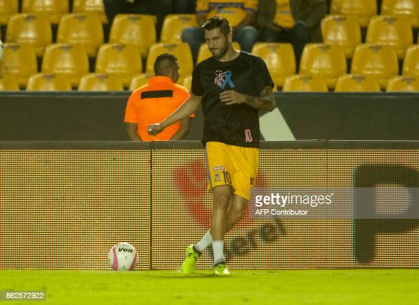 Tigres's French footballer AndrePierre Gignac warms up before the start of the Mexican Apertura 2017 tournament football match against Veracruz at...