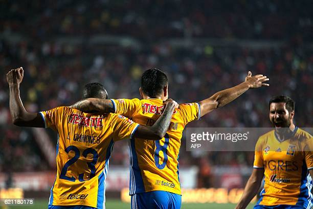 Tigres's Lucas Zelarayan celebrates with teammates Luis Quinones and Andre Pierre Gignac after scoring against Tijuana during their Mexican Apertura...