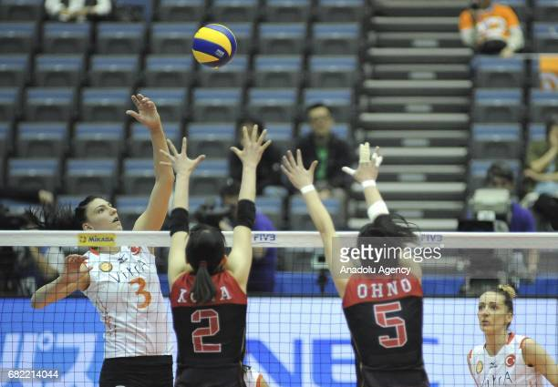 Tijana Boskovic of Eczacibasi Istanbul in action against Sarina Koga and Kana Ono of Nec Red Rockets during the pool match of the FIVB Womens Club...