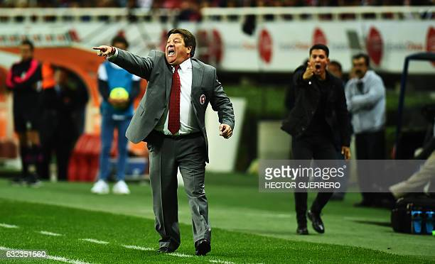 Tijuana coach Miguel Herrera gives instructions to his players during their Mexican Clausura 2017 tournament football match against Guadalajara at...