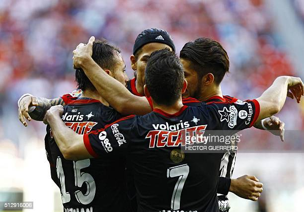 Tijuana players celebrate after scoring a goal against Guadalajara during their Mexican Clausura 2016 tournament football match at Omnilife stadium...