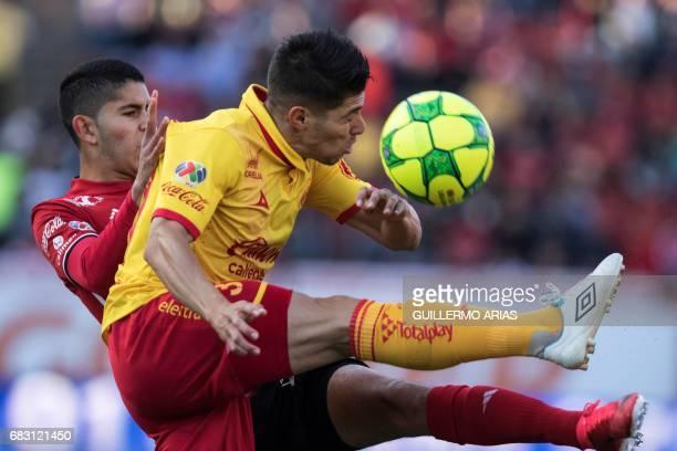 Tijuana's Alfredo Perez vies for the ball with Morelia's Gaston Lezcano during the quarterfinal second leg football match of the Mexican Clausura...