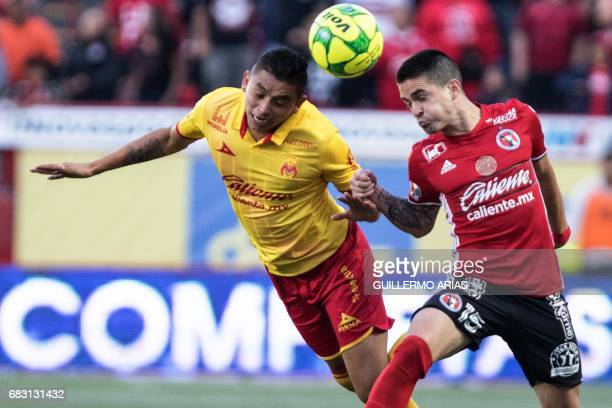 Tijuana's Alfredo Perez vies for the ball with Morelia's Miguel Sensores during the quarterfinal second leg football match of the Mexican Clausura...