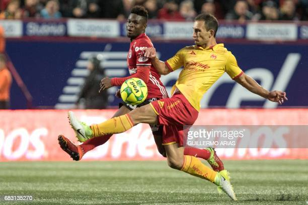Tijuana's Aviles Hurtado vies for the ball with Morelia`s Emanuel Loeschbor during the second leg of their Mexican Clausura 2017 Tournament football...
