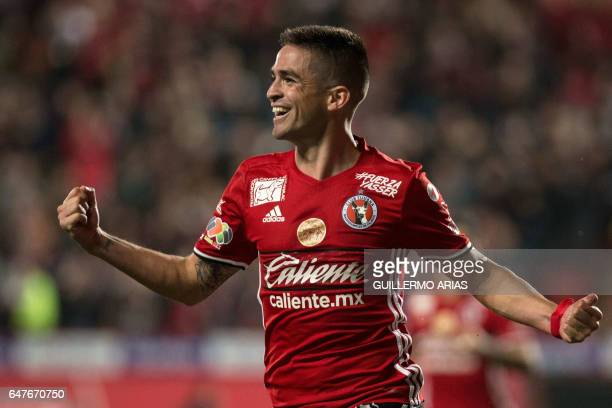 Tijuana's defender Damian Alfredo Perez celebrates after scoring a goal against Pachuca during their Mexican Clausura 2017 Tournament football match...