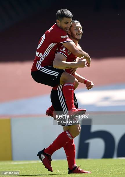Tijuana's defender Guido Rodriguez celebrates with teammate Victor Malcorra after scoring against Pumas during their Mexican Clausura football...