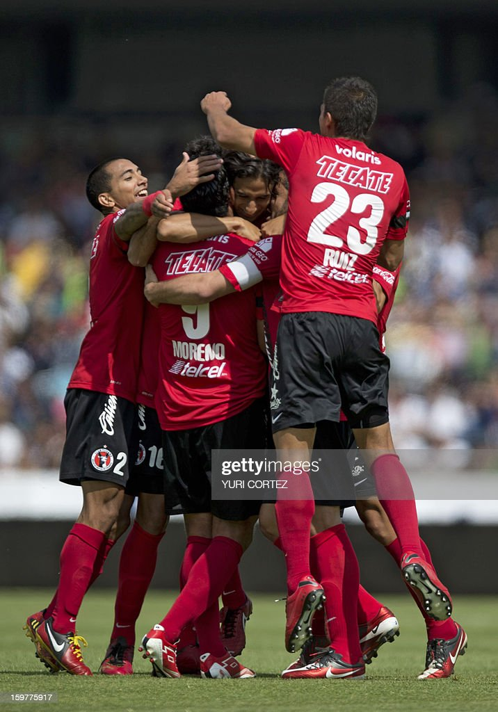 Tijuana's Fernando Arce (C) celebrates with teammates after scoring the second goal of the team against Pumas during their Mexican Clausura tournament 2013 football match at the Olympic stadium on January 20, 2013 in Mexico City. AFP PHOTO/ Yuri CORTEZ