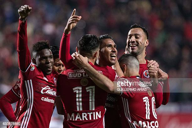 Tijuana's footballers celebrate after scoring a goal against Cruz Azul during their Mexican Clausura Tournament football match at the Caliente...