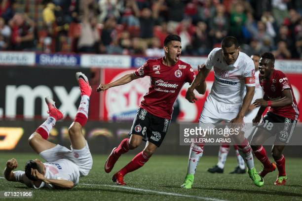 Tijuana's Joe Corona celebrates after scoring a goal against Toluca during their Mexican Clausura 2017 Tournament football match at the Caliente...