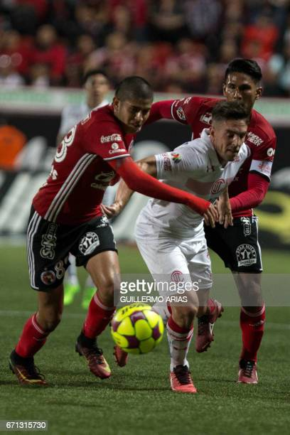 Tijuana's Juan Valenzuela and teammate Carlos Vargas vie for the ball with Toluca`s Gabriel Huache during their Mexican Clausura 2017 Tournament...