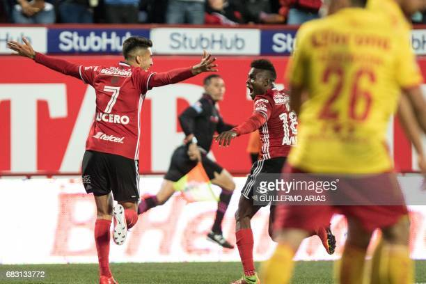 Tijuana's Martin Lucero celebrates with teammate Aviles Hurtado after scoring against Morelia during the second leg of their Mexican Clausura 2017...