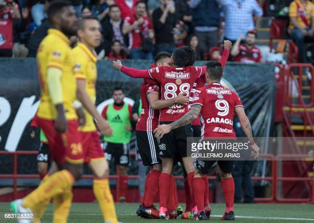 Tijuana's players celebrate after scoring against Morelia during the quarterfinal second leg football match of the Mexican Clausura tournament at the...