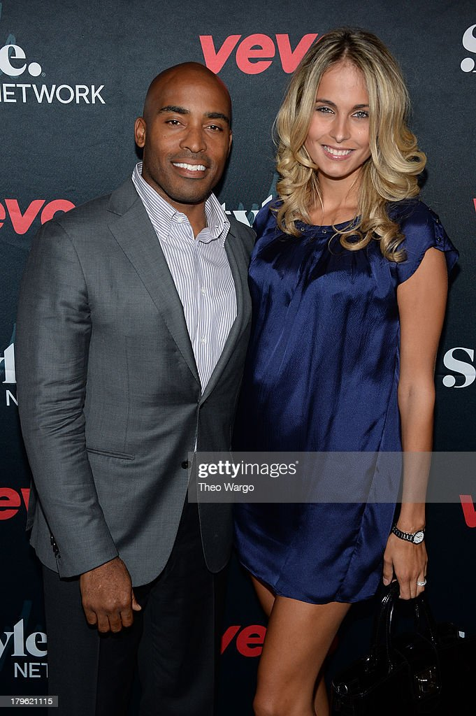 Tiki Barber and wife Traci Lynn Johnson attend the VEVO and Styled To Rock Celebration Hosted by Actress, Model and 'Styled to Rock' Mentor Erin Wasson with Performances by Bridget Kelly & Cazzette on September 5, 2013 in New York City.
