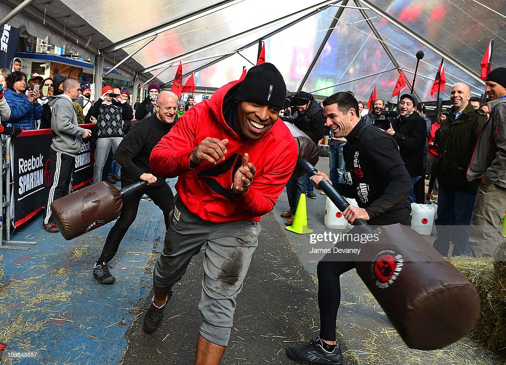 Tiki Barber tackles The Reebok Spartan Race Times Square Challenge in Times Square on January 17, 2013 in New York City.
