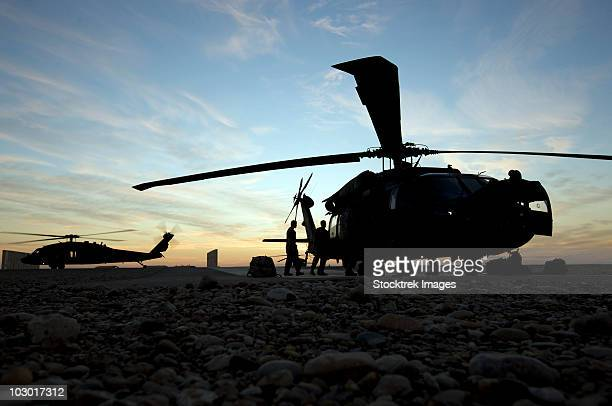 Tikrit, Iraq - A UH-60 Black Hawk helicopter on the flight line at sunset.
