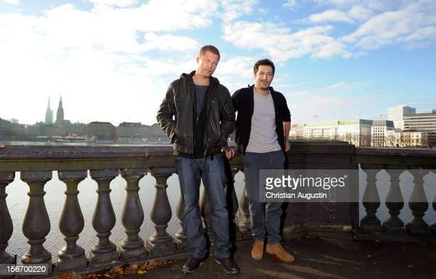 Til Schweiger and Fahri Yardim attend a photocall at 'Tatort' set filming on Kennedybruecke on November 19 2012 in Hamburg Germany
