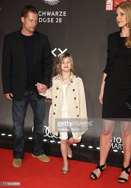 Til Schweiger and his daughter Emma as well as his girl friend Svenja Holtmann arrive for the new faces award at BCC on April 7 2011 in Berlin Germany