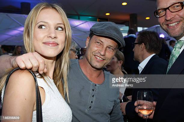 Til Schweiger and partner Svenja Holtmann attend the producer party 2012 of the German producers alliance on June 14 2012 in Berlin Germany