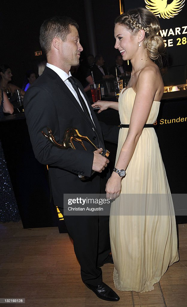 <a gi-track='captionPersonalityLinkClicked' href=/galleries/search?phrase=Til+Schweiger&family=editorial&specificpeople=740750 ng-click='$event.stopPropagation()'>Til Schweiger</a> and Svenja Holtmann attend the Bambi Award 2011 aftershow party at the Rhein-Main-Hallen on November 10, 2011 in Wiesbaden, Germany.