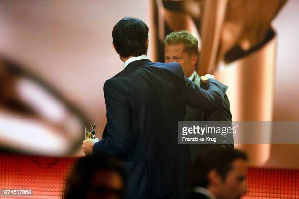 Til Schweiger congratulates Simon Verhoeven on stage for his award for Largest Audience at the Lola German Film Award show at Messe Berlin on April...