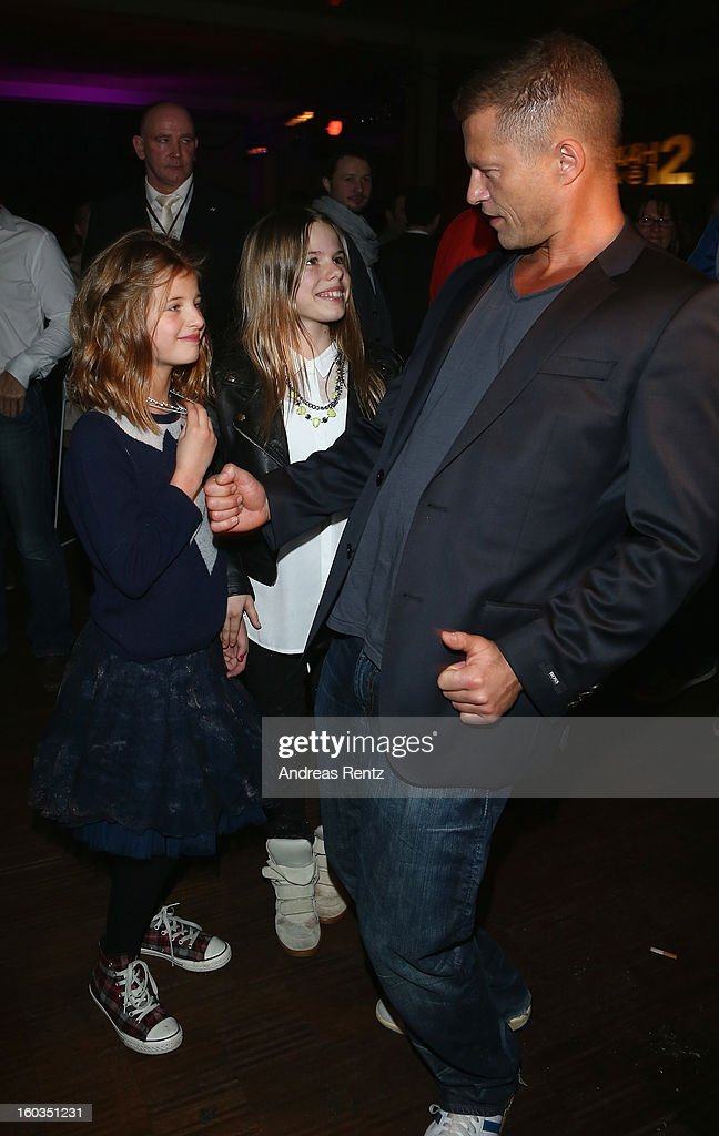 Til Schweiger dances with his daughter Emma (L) and Paula (C) at the after show party to 'Kokowaeaeh 2' - Germany Premiere at Astra on January 29, 2013 in Berlin, Germany.