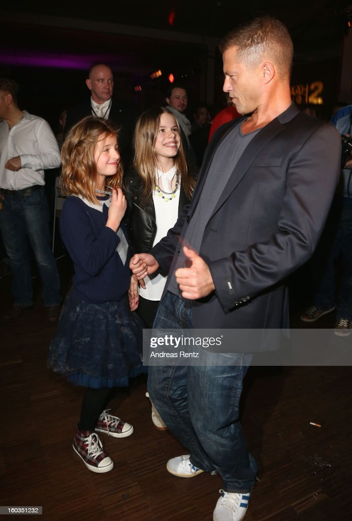 <a gi-track='captionPersonalityLinkClicked' href=/galleries/search?phrase=Til+Schweiger&family=editorial&specificpeople=740750 ng-click='$event.stopPropagation()'>Til Schweiger</a> dances with his daughter Emma (L) and Paula (C) at the after show party to 'Kokowaeaeh 2' - Germany Premiere at Astra on January 29, 2013 in Berlin, Germany.