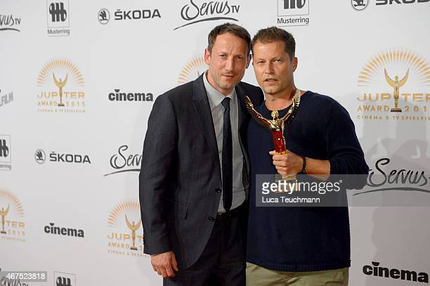 Til Schweiger poses with his prize next to Wotan Wilke Moehring during the Jupiter Award at Cafe Moskau on March 25 2015 in Berlin Germany