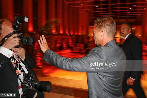 Til Schweiger pushes off a photographer during the German Film Award 2015 Lola party at Palais am Funkturm on June 19 2015 in Berlin Germany