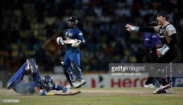 Tilakaratne Dilshan of Sri Lanka is run out by Brendon McCullum of New Zealand during the C1 versus D2 Super Eight match between Sri Lanka and New...