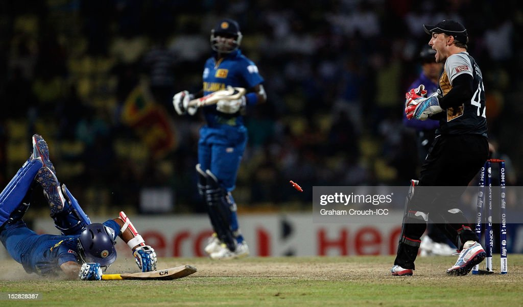Tilakaratne Dilshan of Sri Lanka is run out by <a gi-track='captionPersonalityLinkClicked' href=/galleries/search?phrase=Brendon+McCullum&family=editorial&specificpeople=208154 ng-click='$event.stopPropagation()'>Brendon McCullum</a> of New Zealand during the C1 versus D2 Super Eight match between Sri Lanka and New Zealand at Pallekele Cricket Stadium on September 27, 2012 in Kandy, Sri Lanka.