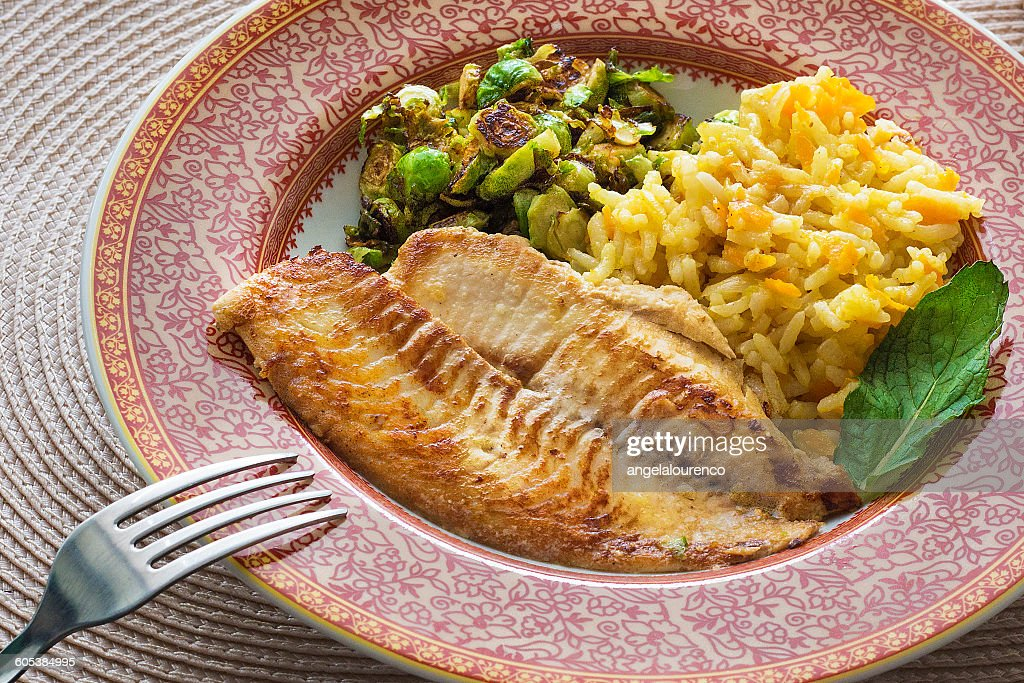 tilapia, rice with carrot and brussels sprouts