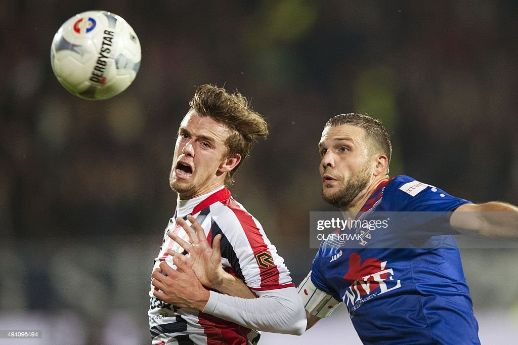 Tilburg's Lucas Andersen vies for the ball with Heerenveen's Joey van den Berg during the Dutch Eredivisie football match between Willem II Tilburg...