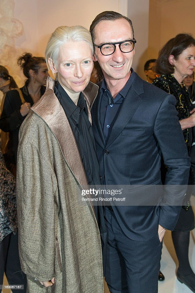 <a gi-track='captionPersonalityLinkClicked' href=/galleries/search?phrase=Tilda+Swinton&family=editorial&specificpeople=202991 ng-click='$event.stopPropagation()'>Tilda Swinton</a> (L) and Bruno Frisoni attend the Roger Vivier Cocktail, to celebrate the launch of the book 'Roger Vivier', as part of Paris Fashion Week on March 4, 2013 in Paris, France.