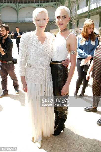 Tilda Swinton and Cara Delevingne attend the Chanel Haute Couture Fall/Winter 20172018 show as part of Haute Couture Paris Fashion Week on July 4...