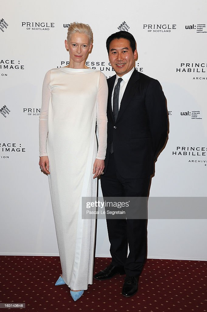 <a gi-track='captionPersonalityLinkClicked' href=/galleries/search?phrase=Tilda+Swinton&family=editorial&specificpeople=202991 ng-click='$event.stopPropagation()'>Tilda Swinton</a> and Douglas Fang attend the Pringle Of Scotland Archive Collection Presentation as part of Paris Fashion Week at Salon France-Ameriques on March 5, 2013 in Paris, France.