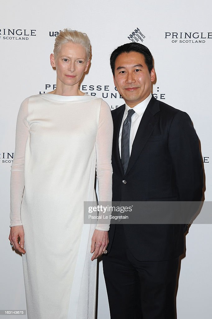 Tilda Swinton and Douglas Fang attend the Pringle Of Scotland Archive Collection Presentation as part of Paris Fashion Week at Salon France-Ameriques on March 5, 2013 in Paris, France.