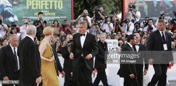 Tilda Swinton and George Clooney attend the opening night screening for Burn After Reading at the 65th Venice Film Festival Venice Italy