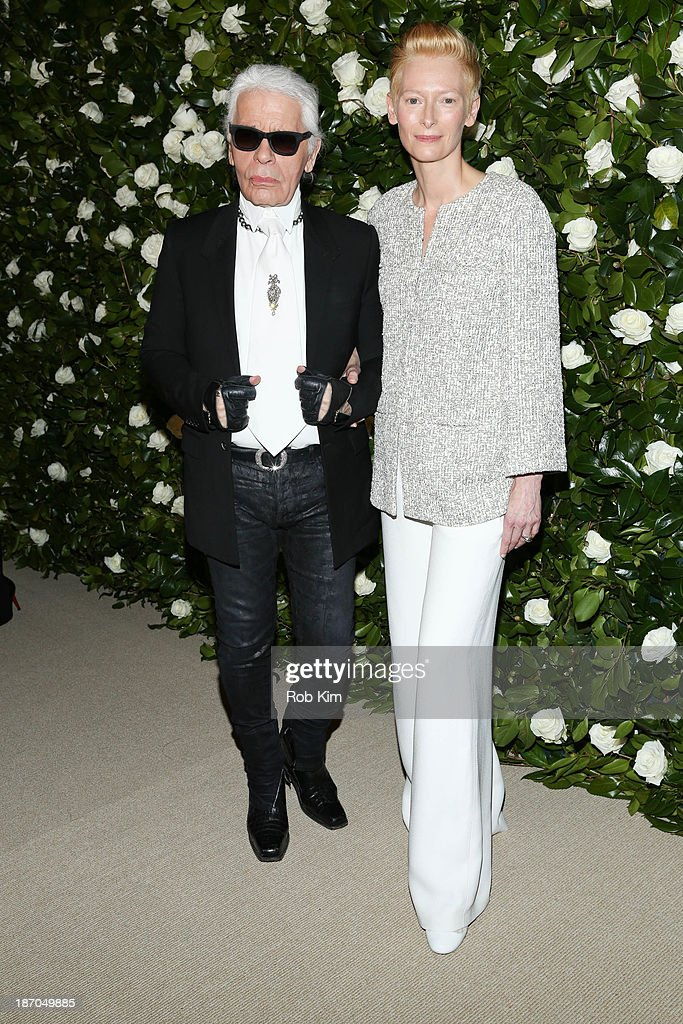 <a gi-track='captionPersonalityLinkClicked' href=/galleries/search?phrase=Tilda+Swinton&family=editorial&specificpeople=202991 ng-click='$event.stopPropagation()'>Tilda Swinton</a> (R) and <a gi-track='captionPersonalityLinkClicked' href=/galleries/search?phrase=Karl+Lagerfeld+-+Fashion+Designer&family=editorial&specificpeople=4330565 ng-click='$event.stopPropagation()'>Karl Lagerfeld</a> attend the Museum of Modern Art 2013 Film benefit: A Tribute To <a gi-track='captionPersonalityLinkClicked' href=/galleries/search?phrase=Tilda+Swinton&family=editorial&specificpeople=202991 ng-click='$event.stopPropagation()'>Tilda Swinton</a> on November 5, 2013 in New York City.