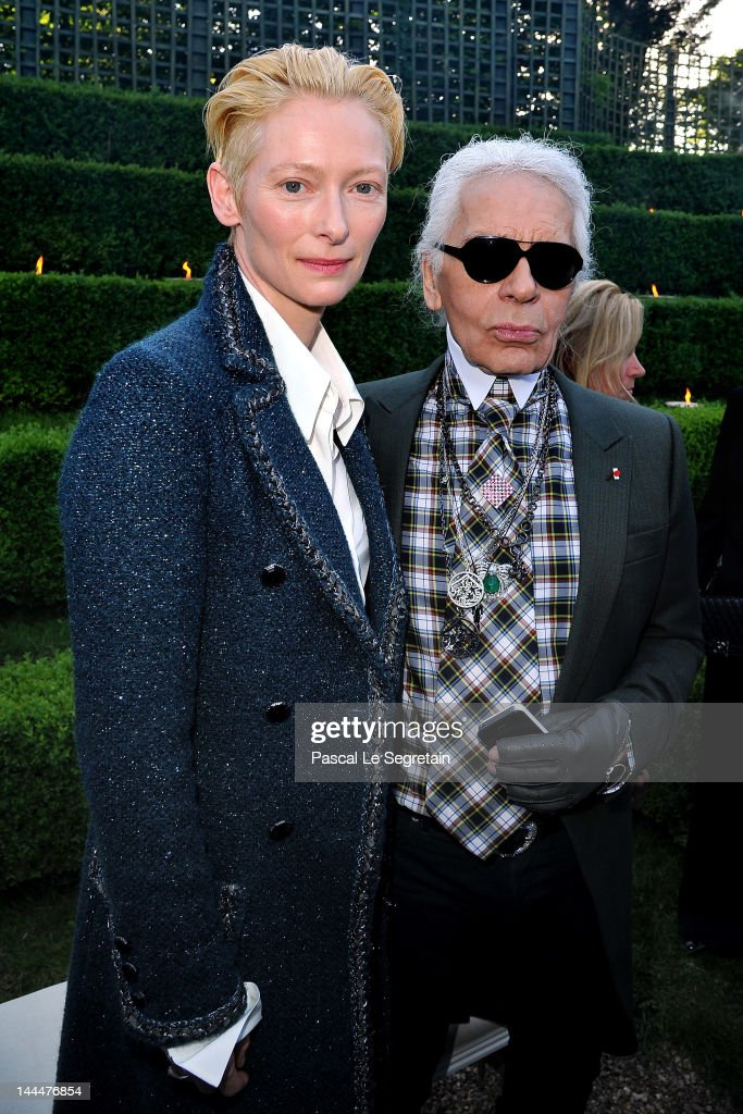 <a gi-track='captionPersonalityLinkClicked' href=/galleries/search?phrase=Tilda+Swinton&family=editorial&specificpeople=202991 ng-click='$event.stopPropagation()'>Tilda Swinton</a> and Karl Lagerfeld pose during the Chanel 2012/13 Cruise Collection at Chateau de Versailles on May 14, 2012 in Versailles, France.