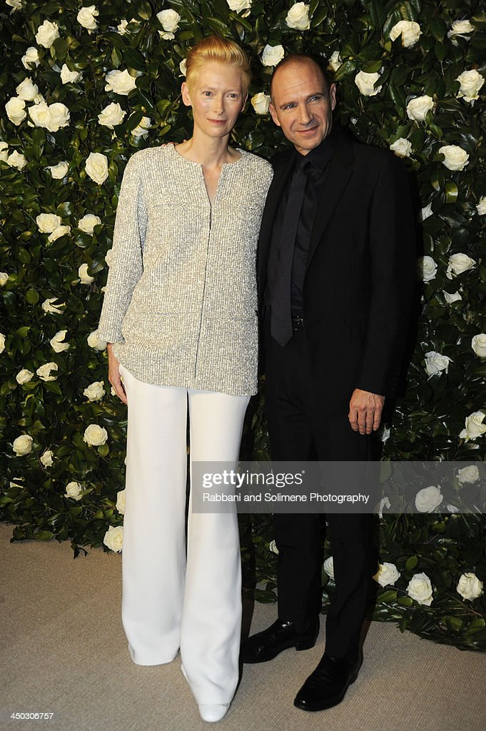<a gi-track='captionPersonalityLinkClicked' href=/galleries/search?phrase=Tilda+Swinton&family=editorial&specificpeople=202991 ng-click='$event.stopPropagation()'>Tilda Swinton</a> and <a gi-track='captionPersonalityLinkClicked' href=/galleries/search?phrase=Ralph+Fiennes&family=editorial&specificpeople=206461 ng-click='$event.stopPropagation()'>Ralph Fiennes</a> attends the Museum of Modern Art 2013 Film benefit - A Tribute To <a gi-track='captionPersonalityLinkClicked' href=/galleries/search?phrase=Tilda+Swinton&family=editorial&specificpeople=202991 ng-click='$event.stopPropagation()'>Tilda Swinton</a> on November 5, 2013 in New York City.