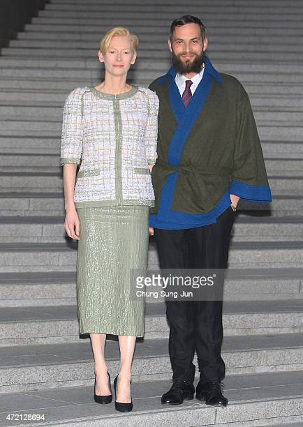 Tilda Swinton and Sandro Kopp arrive the Chanel 2015/16 Cruise Collection show on May 4 2015 in Seoul South Korea