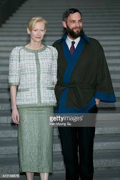 Tilda Swinton and Sandro Kopp attend the Chanel 2015/16 Cruise Collection show on May 4 2015 in Seoul South Korea