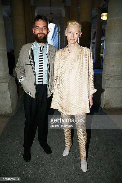 Tilda Swinton and Sandro Kopp attend the mytheresacom Haider Ackermann Dinner At Le Grand Vefour as part of Paris Fashion Week Haute Couture...