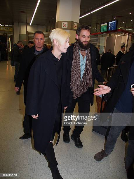 Tilda Swinton and Sandro Kopp sighted at Tegel Airport on February 5 2014 in Berlin Germany