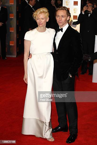 Tilda Swinton and Tom Hiddleston attend the Orange British Academy Film Awards at The Royal Opera House on February 12 2012 in London England
