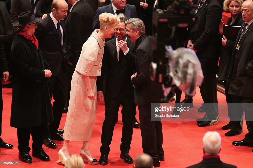 <a gi-track='captionPersonalityLinkClicked' href=/galleries/search?phrase=Tilda+Swinton&family=editorial&specificpeople=202991 ng-click='$event.stopPropagation()'>Tilda Swinton</a>, <a gi-track='captionPersonalityLinkClicked' href=/galleries/search?phrase=Ethan+Coen&family=editorial&specificpeople=1130888 ng-click='$event.stopPropagation()'>Ethan Coen</a> and <a gi-track='captionPersonalityLinkClicked' href=/galleries/search?phrase=George+Clooney&family=editorial&specificpeople=202529 ng-click='$event.stopPropagation()'>George Clooney</a> attend the 'Hail, Caesar!' premiere during the 66th Berlinale International Film Festival Berlin at Berlinale Palace on February 11, 2016 in Berlin, Germany.