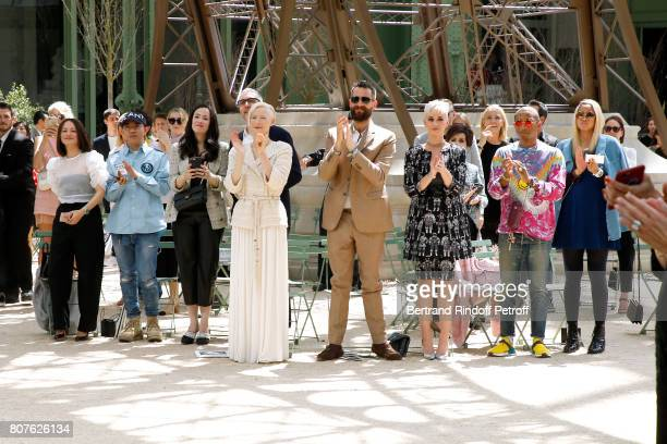 Tilda Swinton her husband Sandro Kopp Katy Perry Pharrell Williams and Helen Lasichanh attend the Chanel Haute Couture Fall/Winter 20172018 show as...