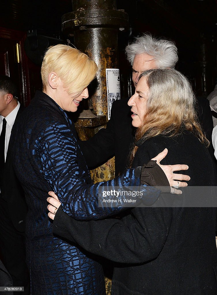 <a gi-track='captionPersonalityLinkClicked' href=/galleries/search?phrase=Tilda+Swinton&family=editorial&specificpeople=202991 ng-click='$event.stopPropagation()'>Tilda Swinton</a>, <a gi-track='captionPersonalityLinkClicked' href=/galleries/search?phrase=Jim+Jarmusch&family=editorial&specificpeople=208784 ng-click='$event.stopPropagation()'>Jim Jarmusch</a> and <a gi-track='captionPersonalityLinkClicked' href=/galleries/search?phrase=Patti+Smith+-+Godmother+of+Punk&family=editorial&specificpeople=221285 ng-click='$event.stopPropagation()'>Patti Smith</a> attend Sony Pictures Classics' 'Only Lovers Left Alive' screening hosted by The Cinema Society and Stefano Tonchi, Editor in Chief of W Magazine after party at Chalk Point Kitchen on March 12, 2014 in New York City.